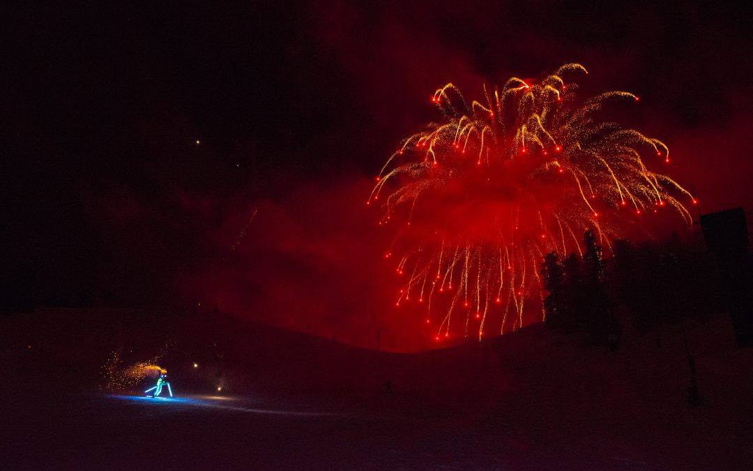 LIGHTING UP THE NIGHT SKY, ON SKIS