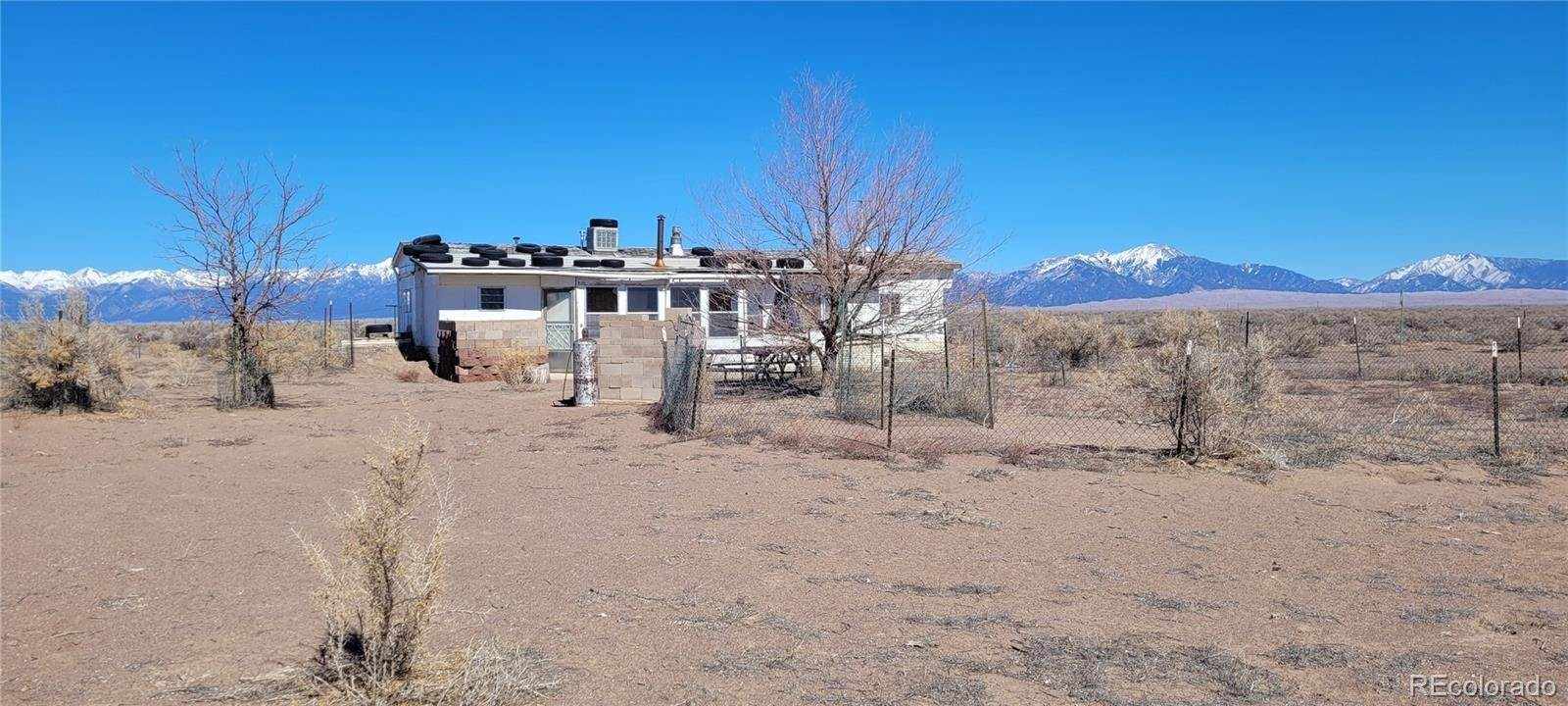 Single Family Homes por un Venta en 10501 N Road 112 Hooper, Colorado 81136 Estados Unidos